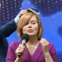 Polish politician Konrad Berkowicz puts a skullcap on the head of rival lawmaker Anna Krupka during a debate in Kielce on May 18, 2019. (screen capture: Twitter)