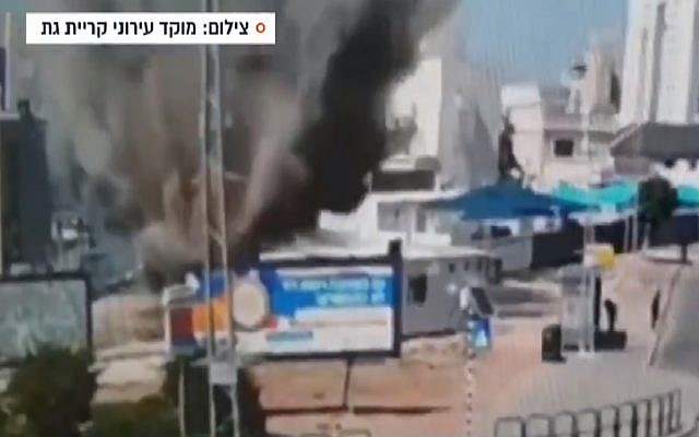 Security footage shows the moment a rocket hits the town of Kiryat Gat, May 4, 2019 (Screen grab via Channel 13 news)
