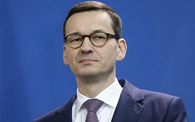 Polish Prime Minister Mateusz Morawiecki listens during a joint press conference with Germany's chancellor, at the Chancellery in Berlin, Germany, on February 16, 2018. (Michele Tantussi/Getty Images via JTA)