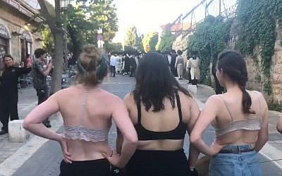 Women who took their tops off at a protest by ultra-Orthodox men in Jerusalem on May 18, 2019. (screenshot)