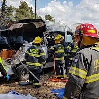 Rescuers at the site of a minibus crash on Route 443 that left four passengers dead and 10 wounded, on May 9, 2019. (Fire and Rescue Services Central District)
