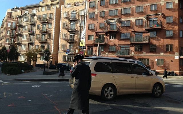 A haredi Orthodox man crosses the street in Williamsburg, Brooklyn. (Gil Shefler via JTA)