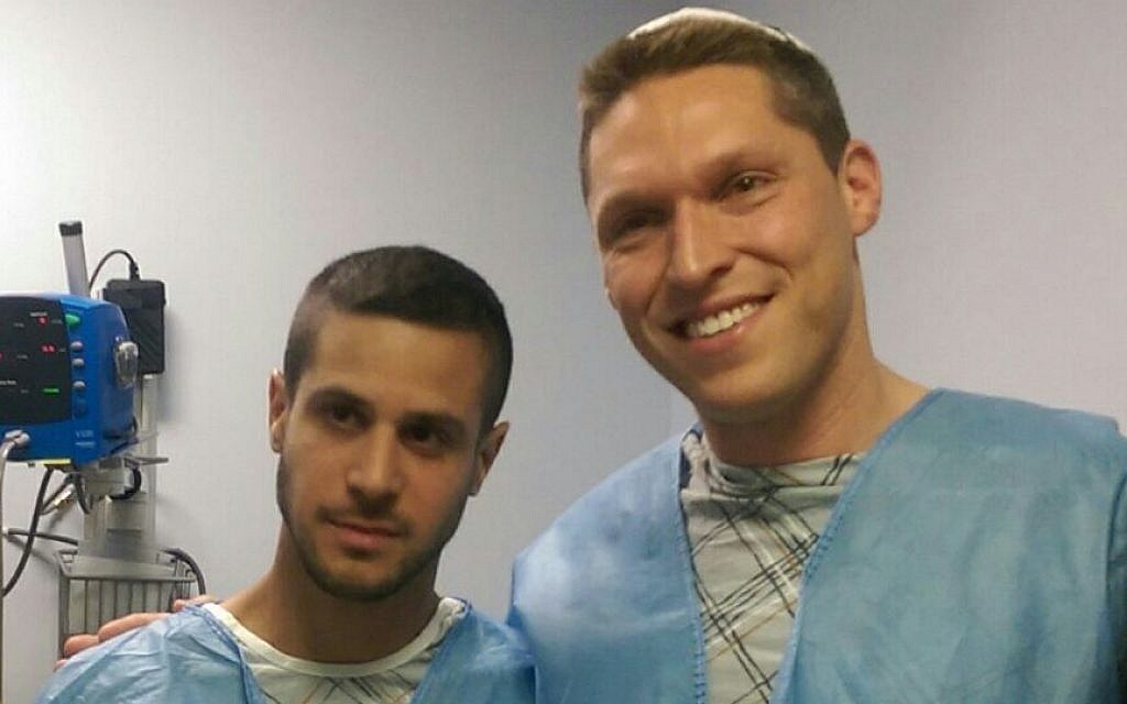 Rabbi Shmuly Yanklowitz, right, at hospital with his kidney recipient. (Courtesy)