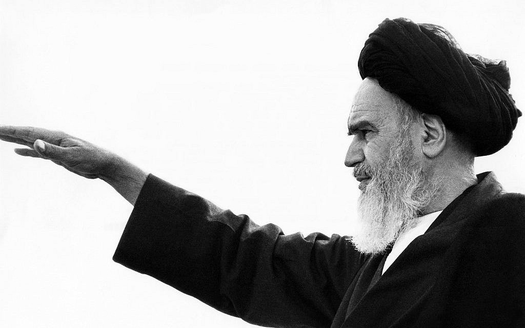 In this photo taken on September 26, 1980,  the late founder of the Islamic Revolution Ayatollah Ruhollah Khomeini salutes his followers in the Iranian capital of Tehran. (Stig Nillson/AFP)