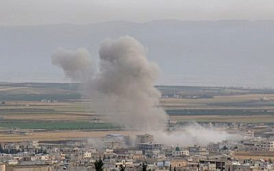 Smoke billows following reported Syrian government forces' bombardment on the town of Khan Sheikhun in the southern countryside of the jihadist-held Idlib province, on June 1, 2019. ( Anas AL-dyab / AFP)