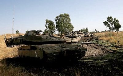 Israeli soldiers maneuver Merkava tanks in the Golan Heights on June 2, 2019. (Photo by JALAA MAREY / AFP)