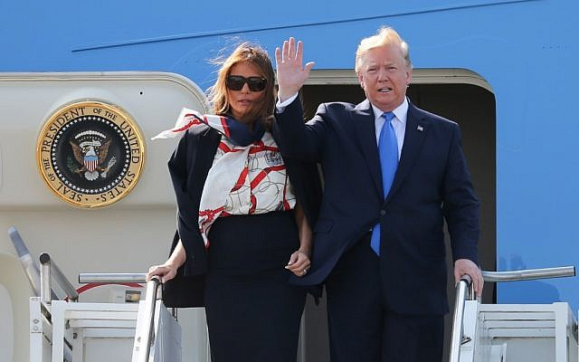 US President Donald Trump waves as he and US First Lady Melania Trump disembark Air Force One at Stansted Airport, north of London, on June 3, 2019, as they begin a three-day state visit to the UK. (Isabel Infantes / AFP)