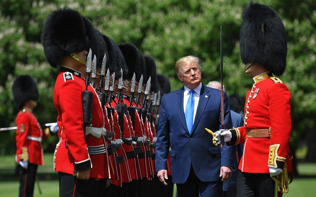 US President Donald Trump inspects an honour guard during a welcome ceremony at Buckingham Palace in central London on June 3, 2019, on the first day of their three-day State Visit to the UK. (MANDEL NGAN / AFP)