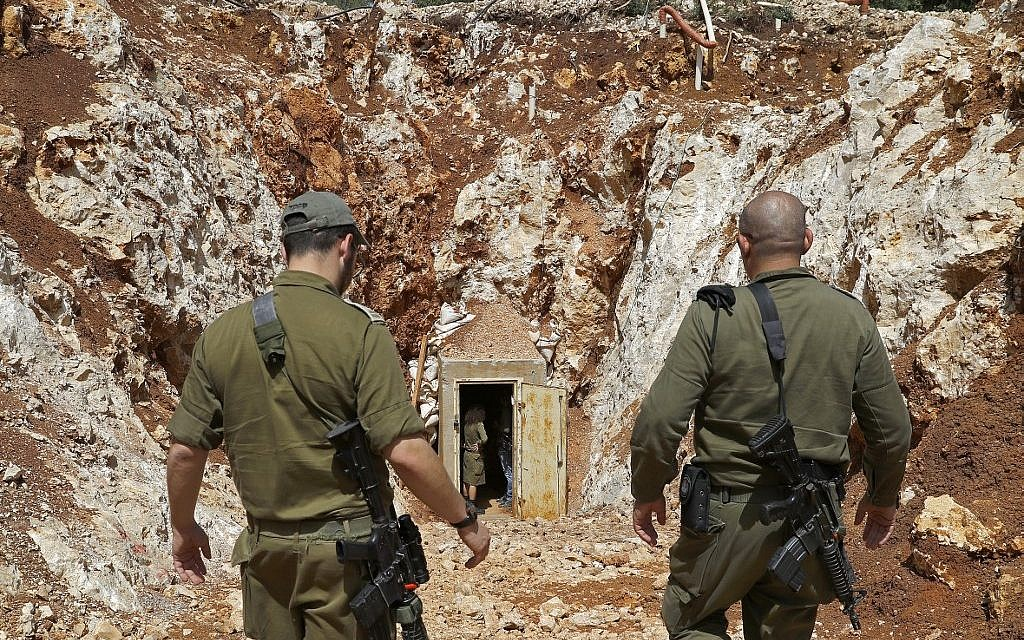 A picture taken on June 3, 2019, during a guided tour with the IDF shows soldiers walking near the entrance to a tunnel at the Israeli side of the border with Lebanon.  (Jack Guez/AFP)