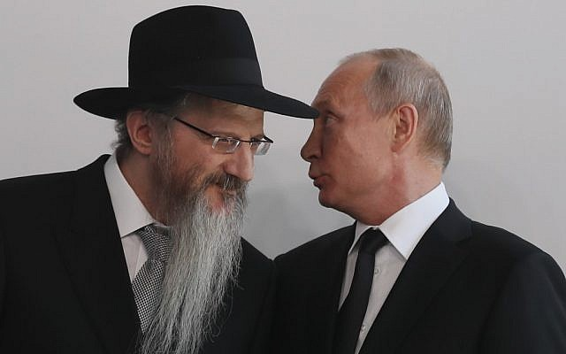 Russian President Vladimir Putin, right, speaks with Chief Rabbi of Russia Berel Lazar, left, during a ceremony unveiling the memorial to members of the Jewish resistance in Nazi concentration camps during World War II, at the Jewish Museum and Tolerance Center in Moscow on June 4, 2019. (Sergei Ilnitsky/ Pool/AFP)