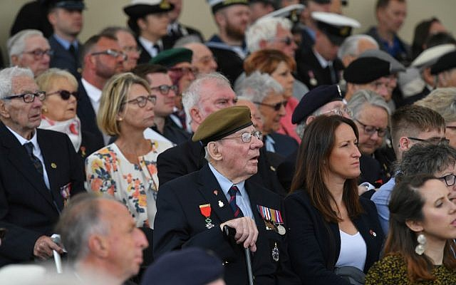 Veterans watch during an event to commemorate the 75th anniversary of the D-Day landings, in Portsmouth, southern England, on June 5, 2019. (Mandel Ngan/AFP)