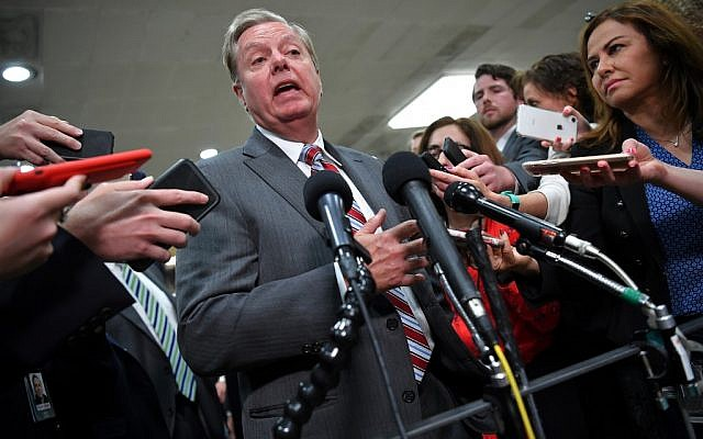 In this file photo taken on May 21, 2019 US Senator from South Carolina Lindsey Graham gives a statement after closed-door briefing on Iran in the auditorium of the Capitol Visitors Center in Washington, DC. (Photo by MANDEL NGAN / AFP)