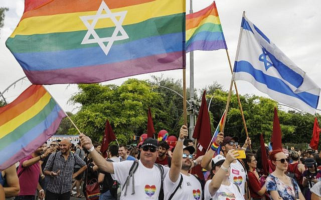 People take part in the 18th annual Jerusalem Gay Pride parade on June 6, 2019. (Menahem Kahana/AFP)