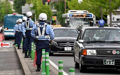 Police officers check traffic near the G20 Finance Ministers and Central Bank Governors meeting site in Fukuoka on June 7, 2019. (Toshifumi KITAMURA / AFP)
