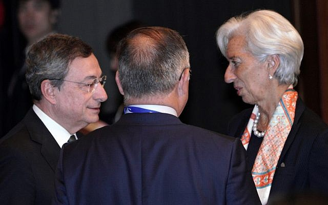 International Monetary Fund (IMF) Managing Director Christine Lagarde (R) and European Central Bank (ECB) President Mario Draghi (L) speak prior to the G20 finance ministers and central bank governors meeting in Fukuoka on June 8, 2019. (Eugene Hoshiko / POOL / AFP)