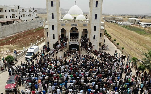 A picture taken with a drone on June 9, 2019 shows Syrians attending the funeral of late rebel fighter Abdel-Basset al-Sarout, in al-Dana in Syria's jihadist-controlled Idlib region, near the border with Turkey. (Omar Haj Kadour/AFP)