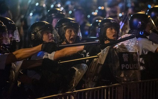 Riot police shout at protesters during clashes after a rally against a controversial extradition law proposal in Hong Kong on June 10, 2019 (Philip Fong/AFP)