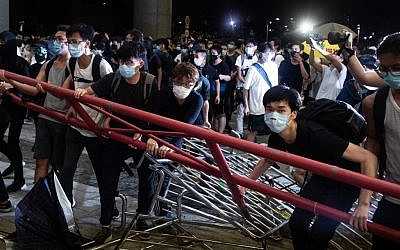 Hong Kong leader apologises after massive protests