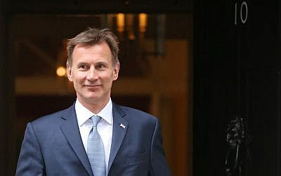 Britain's Foreign Secretary Jeremy Hunt leaves 10 Downing Street in London