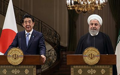Iranian President Hassan Rouhani (R) Japanese Prime Minister Shinzo Abe give a joint press conference at the Saadabad Palace in Iran's capital Tehran on June 12, 2019. (AFP)