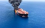 A picture obtained by AFP from Iranian News Agency ISNA on June 13, 2019, reportedly shows fire and smoke billowing from a tanker said to have been attacked in the waters of the Gulf of Oman. (ISNA/AFP)