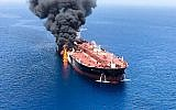 Illustrative: A picture obtained by AFP from Iranian News Agency ISNA on June 13, 2019, shows fire and smoke billowing from a tanker said to have been attacked in the waters of the Gulf of Oman, near the Strait of Hormuz. (ISNA/AFP)