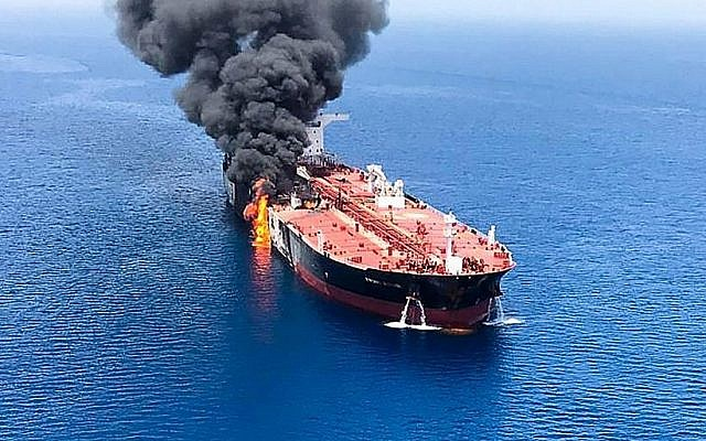 A picture obtained by AFP from Iranian News Agency ISNA on June 13, 2019, shows fire and smoke billowing from a tanker said to have been attacked in the waters of the Gulf of Oman, near the Strait of Hormuz. (ISNA/AFP)