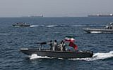 In this file photo taken on April 30, 2019, Iranian soldiers take part in the National Persian Gulf Day in the Strait of Hormuz. (ATTA KENARE / AFP)