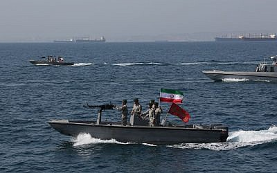 Iranian soldiers take part in the National Persian Gulf Day in the Strait of Hormuz