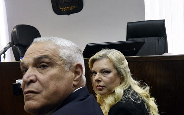 Sara Netanyahu, wife of Prime Minister Benjamin Netanyahu, and her lawyer Yossi Cohen (L) wait for the judge to arrive at the Jerusalem Magistrate's Court on June 16, 2019. (Photo by DEBBIE HILL / AFP)