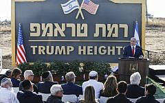 "Prime Minister Benjamin Netanyahu gives a speech before the newly-unveiled sign for the new settlement of ""Ramat Trump"", or ""Trump Heights"" in English, named after the incumbent US President during an official ceremony in the Golan Heights on June 16, 2019. (Jalaa MAREY / AFP)"