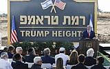 Prime Minister Benjamin Netanyahu gives a speech before the newly-unveiled sign for the new settlement of 'Ramat Trump,' or 'Trump Heights' in English, named after the US President during an official ceremony in the Golan Heights on June 16, 2019. (Jalaa MAREY/AFP)