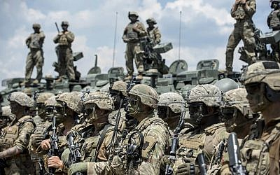 Illustrative -- US soldiers take part in the 'Decisive Strike' military exercise in their camp at the Training Support Center (TSC) Krivolak, near Skopje, on June 17, 2019 (Robert ATANASOVSKI / AFP)