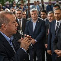 Turkish President Recep Tayyip Erdogan addresses mourners as he attends a symbolic funeral ceremony for the former Egyptian president on June 18, 2019, at Fatih mosque in Istanbul. (Stringer/AFP)