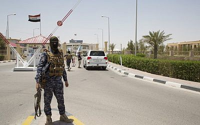 Iraqi soldiers guard the entry of the Zubair oil field after a Katyusha rocket hit a drilling company in the Burjesiya area, a key oil-producing region hosting various Iraqi and foreign companies including US giant Exxon Mobil, north of the Iraqi city of Basra on June 19, 2019. (Hussein Faleh/AFP)
