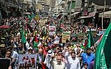 Flags of Jordan and the Muslim Brotherhood are waved with other protest signs denouncing the US-led Middle East economic conference in Bahrain, during a post-Friday prayers demonstration against US President Donald Trump's 'Deal of the Century' in the Jordanian capital Amman on June 21, 2019. ( Khalil MAZRAAWI / AFP)