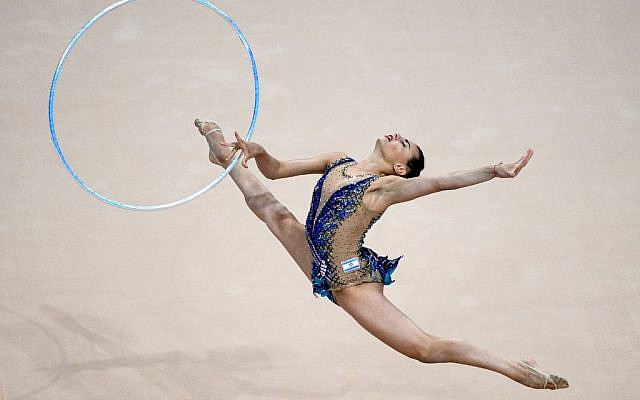 Linoy Ashram competes in the hoop event of the rhythmic gymnastics individual final at the 2019 European Games in Minsk on June 23, 2019. (Kirill KUDRYAVTSEV / AFP)