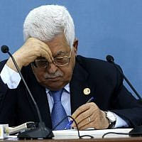 Palestinian Authority President Mahmoud Abbas takes notes during a meeting with journalists in the West Bank town of Ramallah on June 23, 2019. (ABBAS MOMANI / AFP)