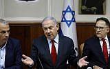 Prime Minister Benjamin Netanyahu (c), Government Secretary Tzahi Braverman (R) and Finance Minister Moshe Kahlon (L) attend a weekly cabinet meeting in Jerusalem on June 24, 2019. (MENAHEM KAHANA / POOL / AFP)