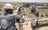 Palestinian electrical workers inspect power installations in the southern Gaza city of Rafah on June 25, 2019. (Said Khatib/AFP)