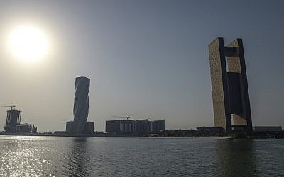"This picture from June 25, 2019, shows a general view of the Four Seasons Hotel (R) in the Bahraini capital Manama, where the ""Peace to Prosperity"" Workshop is taking place. (Stringer/AFP)"