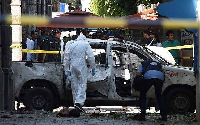 Tunisian forensic workers at the site of bombing attack in the capital's main avenue Habib Bourguiba on June 27, 2019. (FETHI BELAID / AFP)