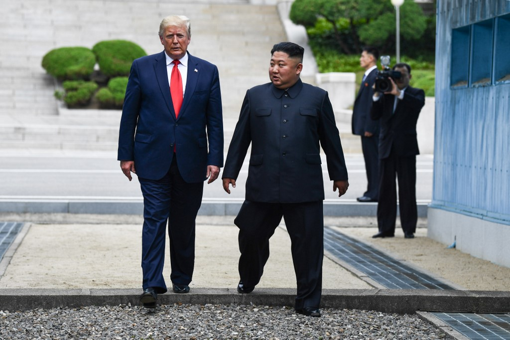 Donald Trump meets Kim Jong-un in demilitarised zone for first time