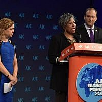 Rep. Brenda Lawrence, D-Mich., flanked by Rep. Debbie Wasserman Schultz, D-Fla., and Rep. Lee Zeldin, R-NY, launches the black-Jewish caucus at the annual American Jewish Committee Global Forum in Washington DC, on June 3, 2019. (AJC via JTA)