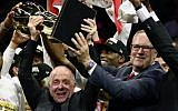 Larry Tanenbaum (L) holds the Larry O'Brien Championship Trophy after the Toronto Raptors defeat the Golden State Warriors to win Game Six of the 2019 NBA Finals at ORACLE Arena on June 13, 2019 in Oakland, California. (Ezra Shaw/Getty Images/AFP)
