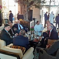"""Illustrative: Yoav Mordechai (L), a former head of the Coordinator of Government Activities in the Territories, speaks with Ashraf Jabari and other Palestinian businessmen ahead of the """"Peace to Prosperity"""" workshop in Manama, Bahrain, June 25, 2019. (Raphael Ahren/Times of Israel)"""