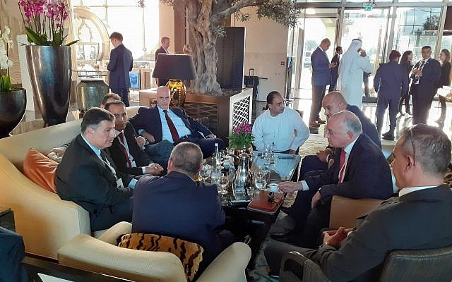 "Illustrative: Yoav Mordechai (L), a former head of the Coordinator of Government Activities in the Territories, speaks with Ashraf Jabari and other Palestinian businessmen ahead of the ""Peace to Prosperity"" workshop in Manama, Bahrain, June 25, 2019. (Raphael Ahren/Times of Israel)"