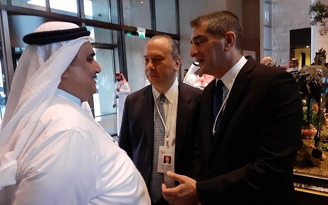 """Bahraini Foreign Minister Khalid bin Ahmed Al Khalifa (L) speaking with Rabbi Marc Schneier and Yitzhak Kreiss, head of the Sheba Medical Center in central Israel, at the """"Peace to Prosperity"""" workshop in Manama, Bahrain, June 25, 2019. (Raphael Ahren/Times of Israel)"""