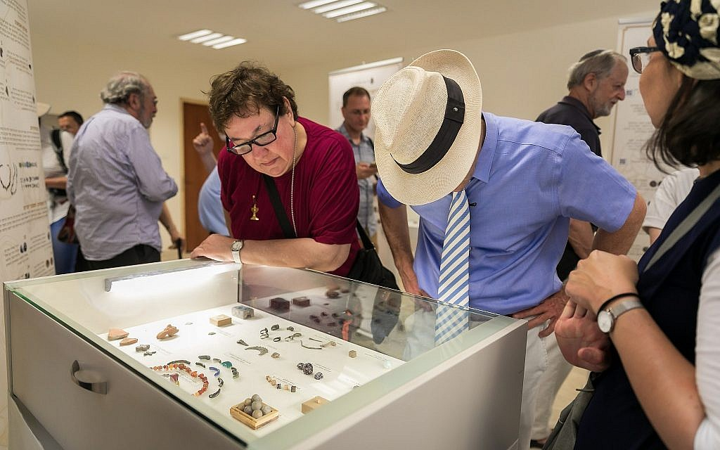Visitors at an exhibit of notable artifacts discovered in the Temple Mount Sifting Project at a one-day exhibit on June 2, 2019. (Yosef Huri)