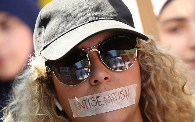A pro-Palestinian protester at the annual al-Quds Day demonstration in Berlin, June 9, 2018. German officials have been accused of muddling their anti-Semitism statistics by labeling all anti-Semitic incidents as carried out by the far right. (Sean Gallup/Getty Images, via JTA)